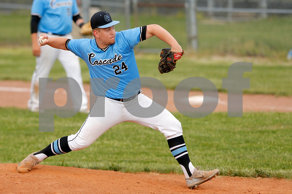 Cascade Cadets player Ira Moore (24) fires the pitch to the plate during the game between the Greencastle Tiger Cubs and Cascade Cadets at Cascade High School in Clayton,IN. (Jeff Brown/Flyer Photo)