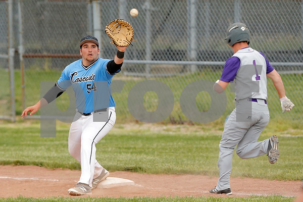 Cascade Cadets first baseman Cameron Ginter (54)  stretches and makes the catch for the out  during the game between the Greencastle Tiger Cubs and Cascade Cadets at Cascade High School in Clayton,IN. (Jeff Brown/Flyer Photo)