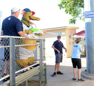 Heater attacks the staff with a squirt gun as the Chico Heat play the Marysville Gold Sox in the third game of a three-game series Saturday, July 30, 2016 at Nettleton Stadium in Chico, California. (Dan Reidel -- Enterprise-Record)