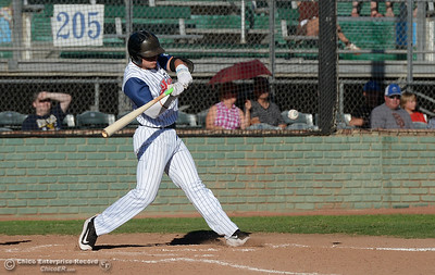 Brock Bell keeps his eye on the ball as he knocks in two runs with a single as the Chico Heat play the Marysville Gold Sox in the third game of a three-game series Saturday, July 30, 2016 at Nettleton Stadium in Chico, California. (Dan Reidel -- Enterprise-Record)