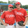 From left, Phillies team manager, Joe Ruth, and Phillies guest pitcher, Josh Geswell, pose for pictures during Sunday's game against the Ronnies at Marshall Park in Lunenburg.