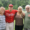 Josh Geswell poses with family after pitching for the Phillies during Sunday's game against the Ronnies at Marshall Park in Lunenburg.  From left, Beth Geswell. Josh Geswell, Eliana Geswell, and Walter Geswell, all of Lunenburg.