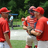 Josh Geswell gets ready to take the pitcher's mound during Sunday's Phillies vs Ronnies game at Marshall Park in Lunenburg.  From left, Alex Heroux, of Leominster, Frank Yavoroshky, of Gardner, and Josh Geswell, of Lunenburg.