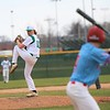 Concord senior Dalton Swineheart (10) winds up for a pitch early in Tuesday's season opener for the Minutemen against Lakeland at Concord High School in Elkhart.