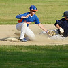 Leominster American Legion's Jeremy Nash attempts to tag Shrewsbury's PJ Browne out in Leominster's 6-5 win on Tuesday evening at Pin Cannovino Field in Leominster. SENTINEL & ENTERPRISE / Ashley Green