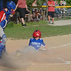 Leominster American's Ashton Molzahn slides into home during the 9-10-year-old Jimmy Fund game against Chuck Stone on Wednesday evening. SENTINEL & ENTERPRISE / Ashley Green