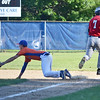 Leominster American Legion first baseman Jeremy Nash dives for a throw on Thursday evening against Grafton Hill, who came away with the 13-4 win. SENTINEL & ENTERPRISE / Ashley Green