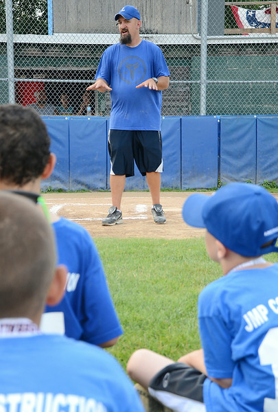 Rob Lora, League President, addresses the teams at the Leominster American Minor League championship at Ronnie Bachand Memorial Field in Leominster on Wednesday evening. SENTINEL & ENTERPRISE / Ashley Green