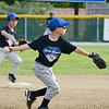 Eagles #10 Eric Walker makes a play to first during the Leominster American Minor League championship game at Ronnie Bachand Memorial Field on Wednesday evening. SENTINEL & ENTERPRISE / Ashley Green