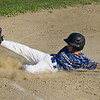 Leominster American's Dylan Vigue slides into third base during the game against Lunenburg on Tuesday evening. SENTINEL & ENTERPRISE / Ashley Green