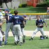 Leominster National storms the field after their victory against Leominster American during Sunday's Leominster Baseball Championship game at Desantis Field.