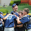 Leominster National celbrates after their victory against Leominster American during Sunday's Leominster Baseball Championship game at Desantis Field.
