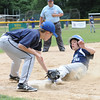 Leominster American's, Brandon Arsenault, fails to stop  Leominster National's Ryan Harris during Sunday's Leominster Baseball Championship at Desantis field.