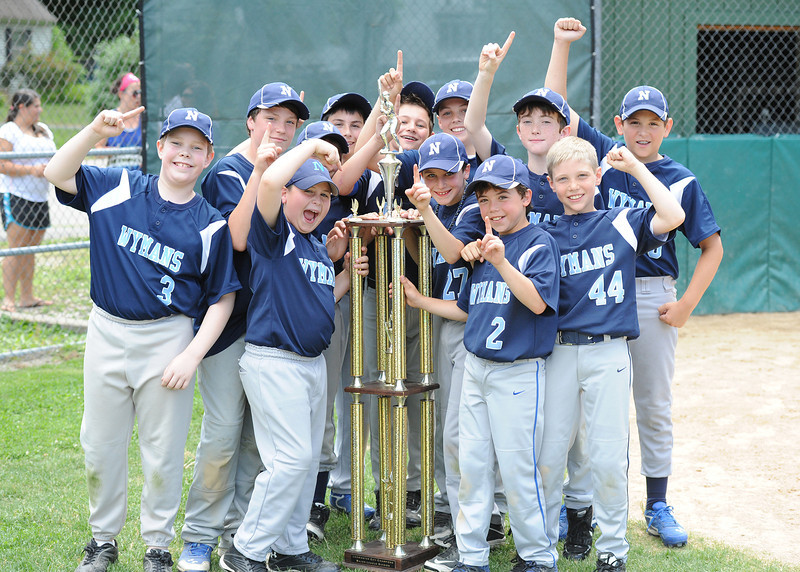 Leominster National celebrates their victory over Leominster American during Sunday's Leominster Baseball Championship at Desantis Field.