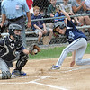 Leominster American catcher, Dylon Carr, tries to stop Leominster National's Jake Richard during Sunday's Leominster Major League City Championship.