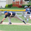 Leominster American's, Will Vargo, tries to stop  Leominster National's, Jake Richard, from making first base during Sunday's Leominster Baseball Championship at Desantis Field.