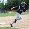Leominster National's, Jake Richard, rounds third base during Sunday's Leominster Baseball Championship at Desantis Field.