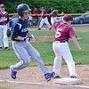 North Leominster's Anthony Hirst tags out Leominster National's Jack Mammone during the Leominster Little League City Championship at Justin DeSantis Field on Wednesday night. SENTINEL & ENTERPRISE / Ashley Green