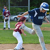 North Leominster's Anthony Hirst tags out Leominster National's Ryan Harris during the Leominster Little League City Championship at Justin DeSantis Field on Wednesday night. SENTINEL & ENTERPRISE / Ashley Green