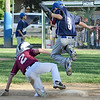North Leominster's  Tom Halliwell slides safely into third base while Leominster American's Dylan Carr jumps out of the way during the Leominster Major League City Championship game on Friday evening. SENTINEL & ENTERPRISE / Ashley Green