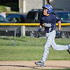 Leominster American's Dylan Sousa runs the bases after hitting a home run during the Leominster Major League City Championship game against North Leominster on Friday evening. SENTINEL & ENTERPRISE / Ashley Green
