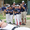 Leominster National teammates come together as teammate Eamon Durkan is carried off the field on a stretcher during the District 3 Major League championship game on Thursday evening. Durkan collided with another player while attempting to field a pop-up. SENTINEL & ENTERPRISE / Ashley Green