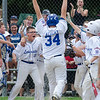 Teammates greet Leominster American's Bradley Albert as he crosses the plate after hitting a homerun during the District 3 Major League championship game on Thursday evening. SENTINEL & ENTERPRISE / Ashley Green