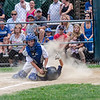 Leominster National's Eamon Durkan slides safely under the tag of Leominster American's Dylan Vigue during the District 3 Major League championship game on Thursday evening. SENTINEL & ENTERPRISE / Ashley Green