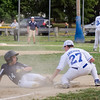 Leominster National's AJ Colarusso slides safely under the tag of Leominster American's Mikey Anderson during the District 3 Major League championship game on Thursday evening. SENTINEL & ENTERPRISE / Ashley Green