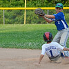 Lunenburg Tyler Hollifield slides in under the tag of Leominster American's Tony Salvatelli  the game on Friday evening. SENTINEL & ENTERPRISE / Ashley Green