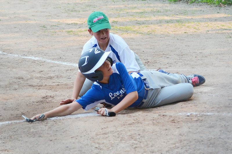 Leominster American's Mike Anderson slides in under the tag of Lunenburg's Phil Arpano on Friday evening. SENTINEL & ENTERPRISE / Ashley Green