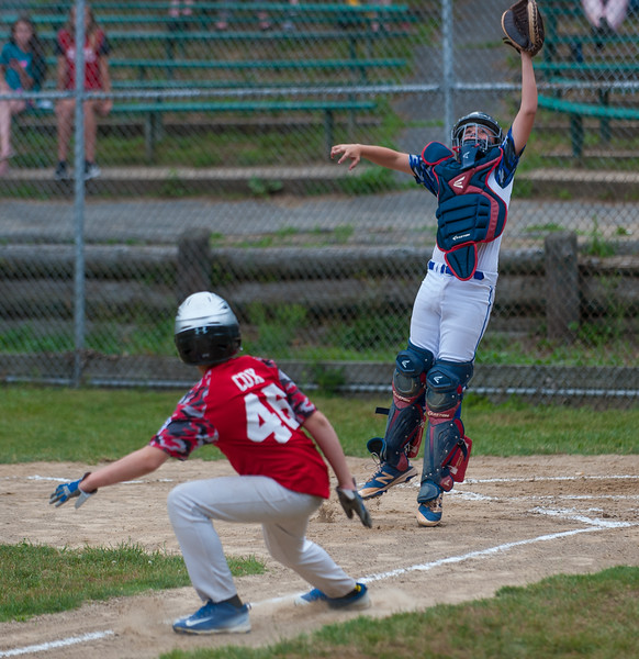 Lunenburg All-Star catcher Phil Arpano goes high for an incoming throw to the plate in the 1st inning against Chuck Stone LL of Athol. The throw was off the mark leading to the 1st Chuck Stone run. The game was held Friday, July 8, 2016. SENTINEL&ENTERPRISE/ Jim Marabello