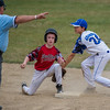 Lunenburg LL All-Star Dylan Adamson (right) apllies a tag too late to Chuck Stone LL's Bean Manning during their playoff gameat Salevan Field in Athol. SENTINEL&ENTERPRISE / Jim Marabello