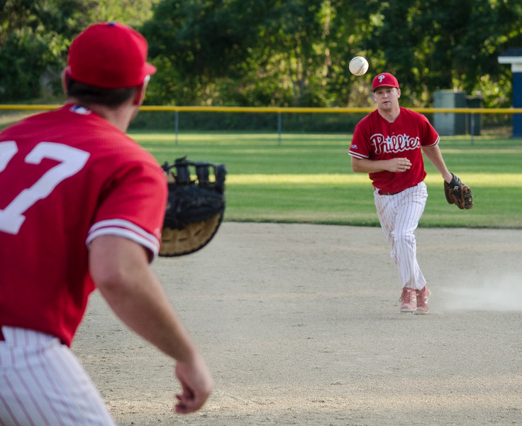 Lunenburg Phillies' secnd baseman Steve LaJoie makes a play to first baseman Pat Gilman during the game against Shrewsbury on Wednesday evening. SENTINEL & ENTERPRISE / Ashley Green