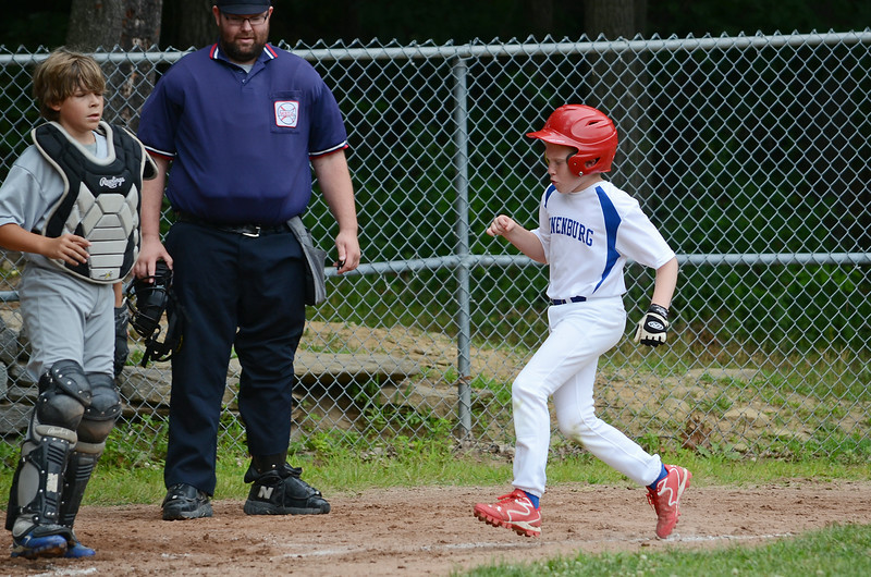 Lunenburg's DJ Lacross crosses the plate during the 11-year-old Jimmy Fund game in the Willie Sinclair division on Saturday afternoon against Leominster National. SENTINEL & ENTERPRISE / Ashley Green