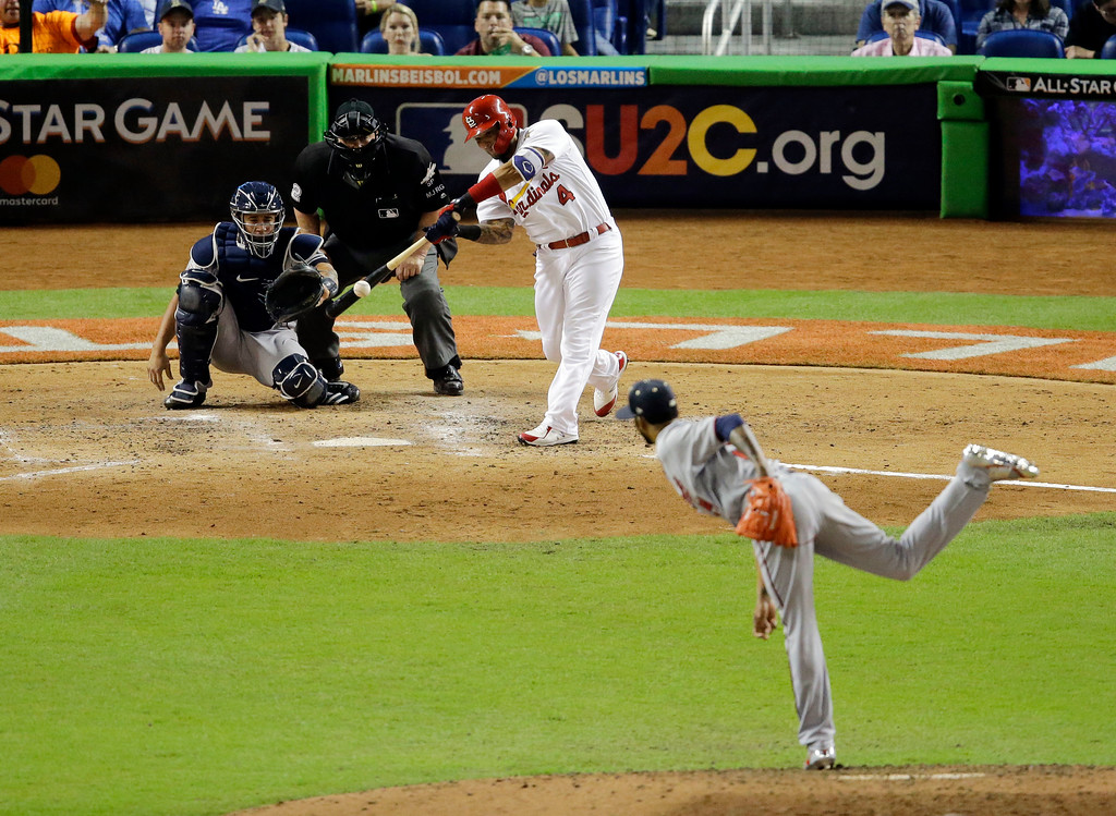 . CORRECTS ID OF THE PITCHER TO MINNESOTA TWINS PITCHER ERVIN SANTANA - National League\'s St. Louis Cardinals\' Yadier Molina (4) hits a home run against American League Minnesota Twins pitcher Ervin Santana (54) in the sixth inning during the MLB baseball All-Star Game, Tuesday, July 11, 2017, in Miami. (AP Photo/Alan Diaz)