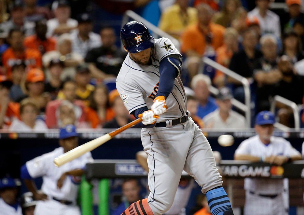 . American League\'s Houston Astros George Springer (4) aims for a hit, during the first inning at the MLB baseball All-Star Game, Tuesday, July 11, 2017, in Miami. (AP Photo/Lynne Sladky)