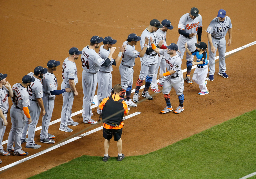 . American League\'s Houston Astros Jose Altuve (27) is greeted by his teammates during the MLB baseball All-Star Game, Tuesday, July 11, 2017, in Miami.(AP Photo/Wilfredo Lee)