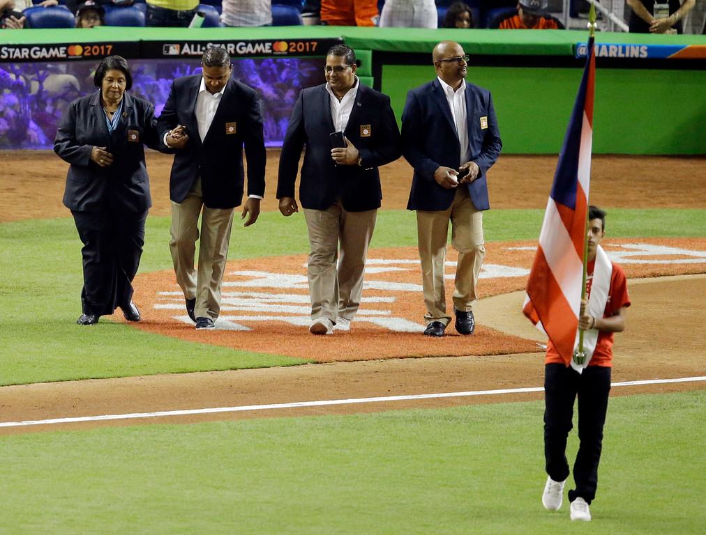 . The family of former player Roberto Clemente, enter the field during the MLB baseball All-Star Game, Tuesday, July 11, 2017, in Miami. (AP Photo/Alan Diaz)