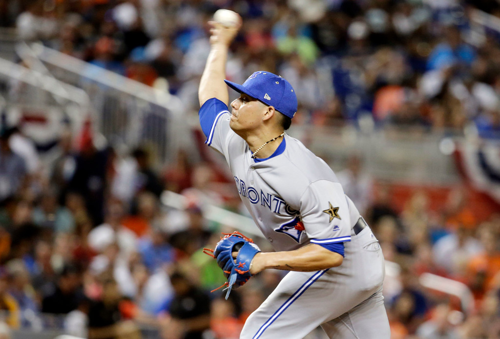 . American League\'s Toronto Blue Jays pitcher Roberto Osuna (54) delivers a pitch in the seventh inning, during the MLB baseball All-Star Game, Tuesday, July 11, 2017, in Miami. (AP Photo/Lynne Sladky)