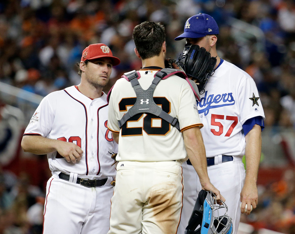 . National League\'s Los Angeles Dodgers pitcher Alex Wood (57), talks to San Francisco catcher Buster Posey (28) and Washington Nationals Daniel Murphy, left, during the fifth inning, at the MLB baseball All-Star Game, Tuesday, July 11, 2017, in Miami. (AP Photo/Lynne Sladky)