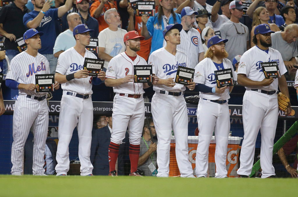 . Members of the National League team remember those affected by cancer, during the MLB baseball All-Star Game, Tuesday, July 11, 2017, in Miami. (AP Photo/Lynne Sladky)