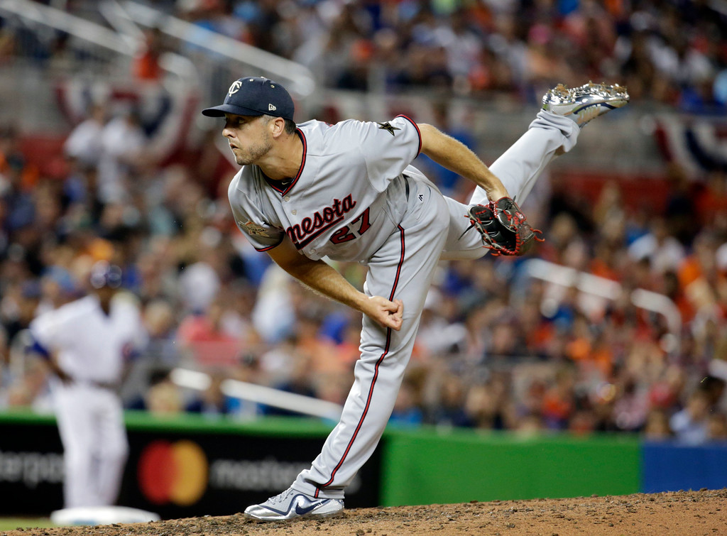 . American League Minnesota Twins pitcher Brandon Kintzler (27), delivers a pitch, in the fifth inning, during the MLB baseball All-Star Game, Tuesday, July 11, 2017, in Miami. (AP Photo/Lynne Sladky)