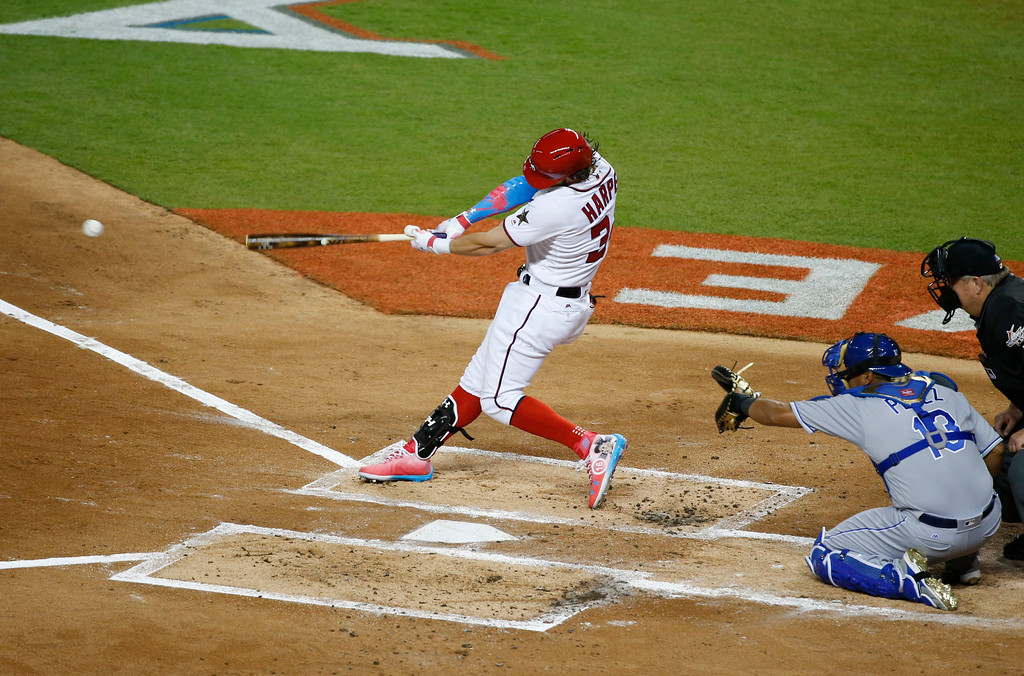 . National League\'s Washington Nationals Bryce Harper (34,) singles to left field, during the first inning at the MLB baseball All-Star Game, Tuesday, July 11, 2017, in Miami. (AP Photo/Wilfredo Lee)