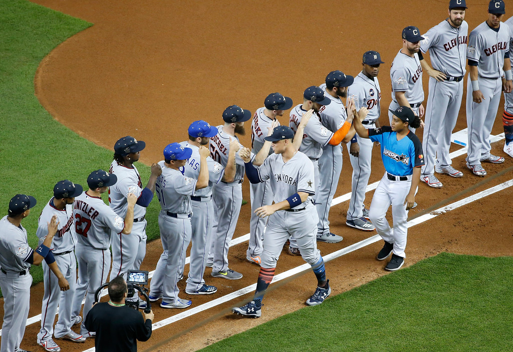 . American League\'s New York Yankees Aaron Judge (99) is greeted by his teammates during the MLB baseball All-Star Game, Tuesday, July 11, 2017, in Miami. (AP Photo/Wilfredo Lee)