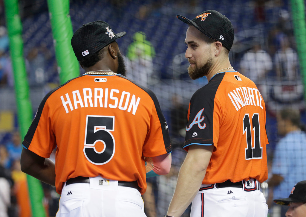 . National League\'s Pittsburgh Pirates second baseman Josh Harrison (5) and Atlanta Braves outfielder Ender Inciarte (11), talk prior to the start of the MLB All-Star game, Tuesday, July 11, 2017, in Miami. (AP Photo/Lynne Sladky)