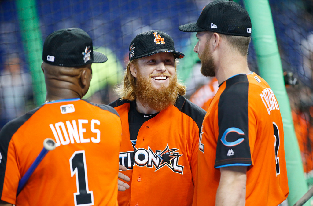 . National League\'s Gary Jones (1), of the Chicago Cubs, left, talks with Los Angeles Dodgers Justin Turner (10) and Cincinnati Reds Zack Cozart (2), prior to the MLB baseball All-Star Game, Tuesday, July 11, 2017, in Miami. (AP Photo/Wilfredo Lee)