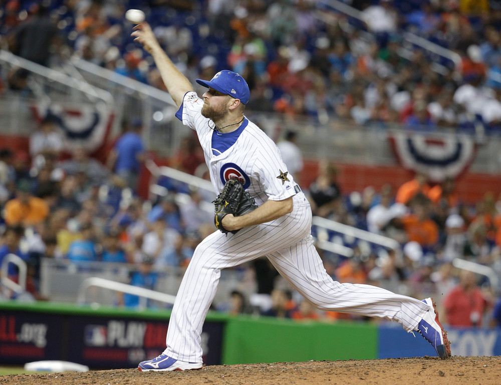 . National League\'s Chicago Cubs pitcher Wade Davis (71), delivers a pitch in the tenth inning, during the MLB baseball All-Star Game, Tuesday, July 11, 2017, in Miami. (AP Photo/Lynne Sladky)