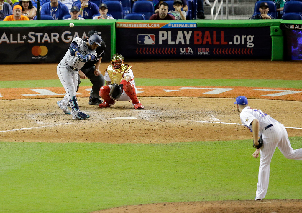 . American League\'s Seattle Mariners Robinson Cano (22), hits the game winning home run in the tenth inning, during the MLB baseball All-Star Game, Tuesday, July 11, 2017, in Miami. The American League defeated the National League 2-1. (AP Photo/Alan Diaz)