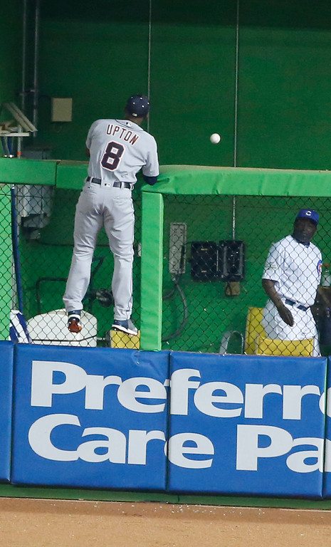 . American League Detroit Tigers outfielder Justin Upton (8), looks at St. Louis Cardinals Molina\'s home run in the sixth inning, at the MLB baseball All-Star Game, Tuesday, July 11, 2017, in Miami. (AP Photo/Wilfredo Lee)
